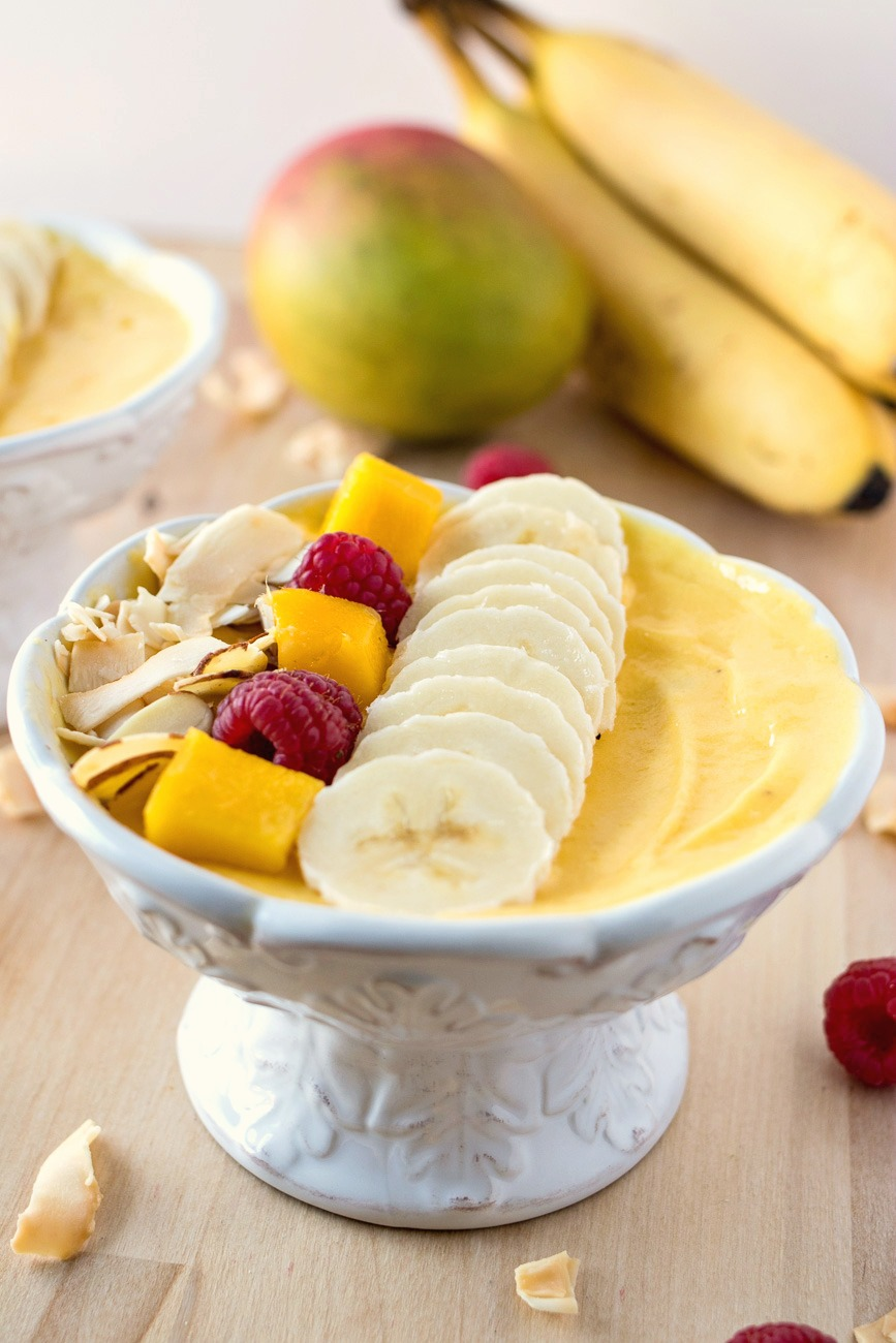 Mango Smoothie Bowl topped with fruit and nuts