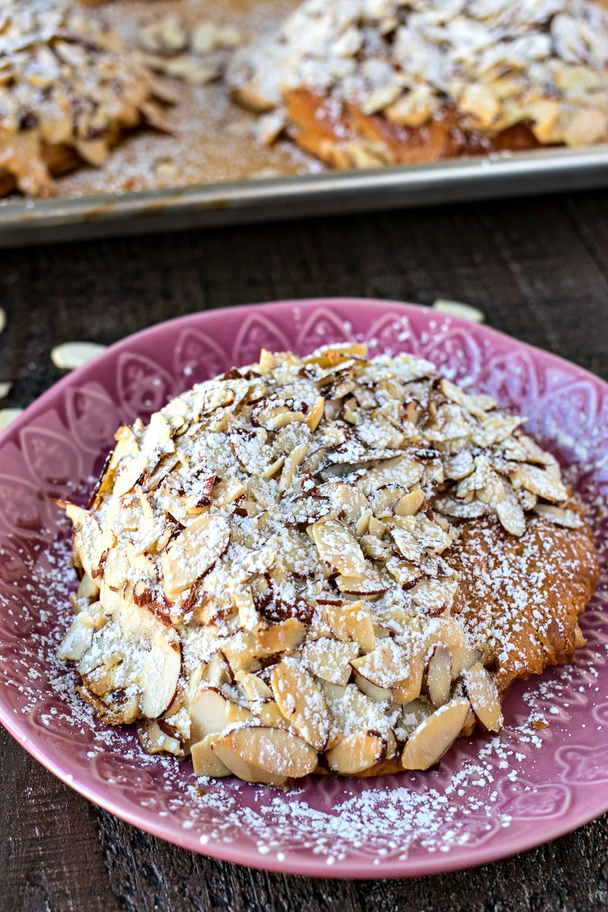 Almond Croissant on a plate topped with powdered sugar
