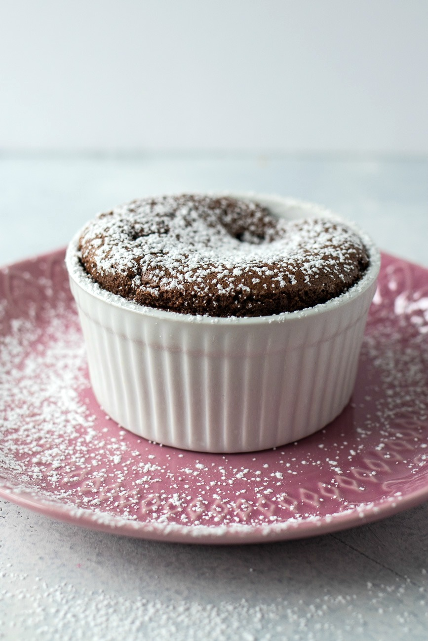 Dish of Chocolate Peanut Butter Souffle topped with powdered sugar