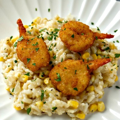 Sweet Corn Risotto with Crispy Shrimp - Creamy, cheesy homemade risotto is taken up a notch with fresh sweet yellow corn and paired perfect with SeaPak Butterfly Shrimp and Clos du Bois Chardonnay.