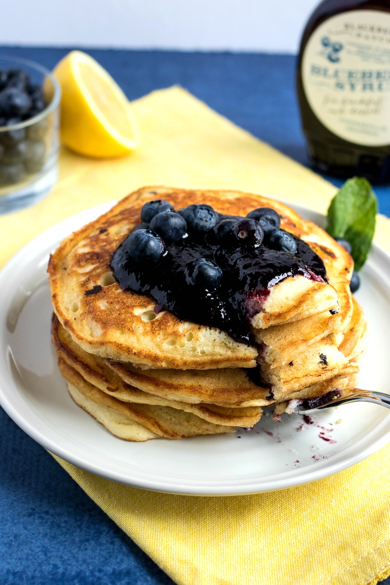 Using a fork to cut Lemon Blueberry Ricotta Pancakes