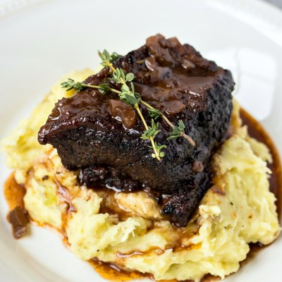 Slow Cooker Short Ribs - Beef short ribs are cooked in a slow cooker to help break down the meat and make it ultra-tender and juicy. Served with a rich red-wine gravy.