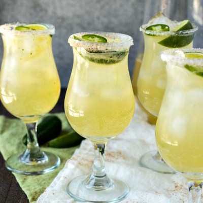 Sparkling Jalapeño Limeade - This refreshing homemade limeade is made by creating a cilantro jalapeño simple syrup and combining with fresh lime juice and sparkling water. It's the best thing to enjoy all summer long!