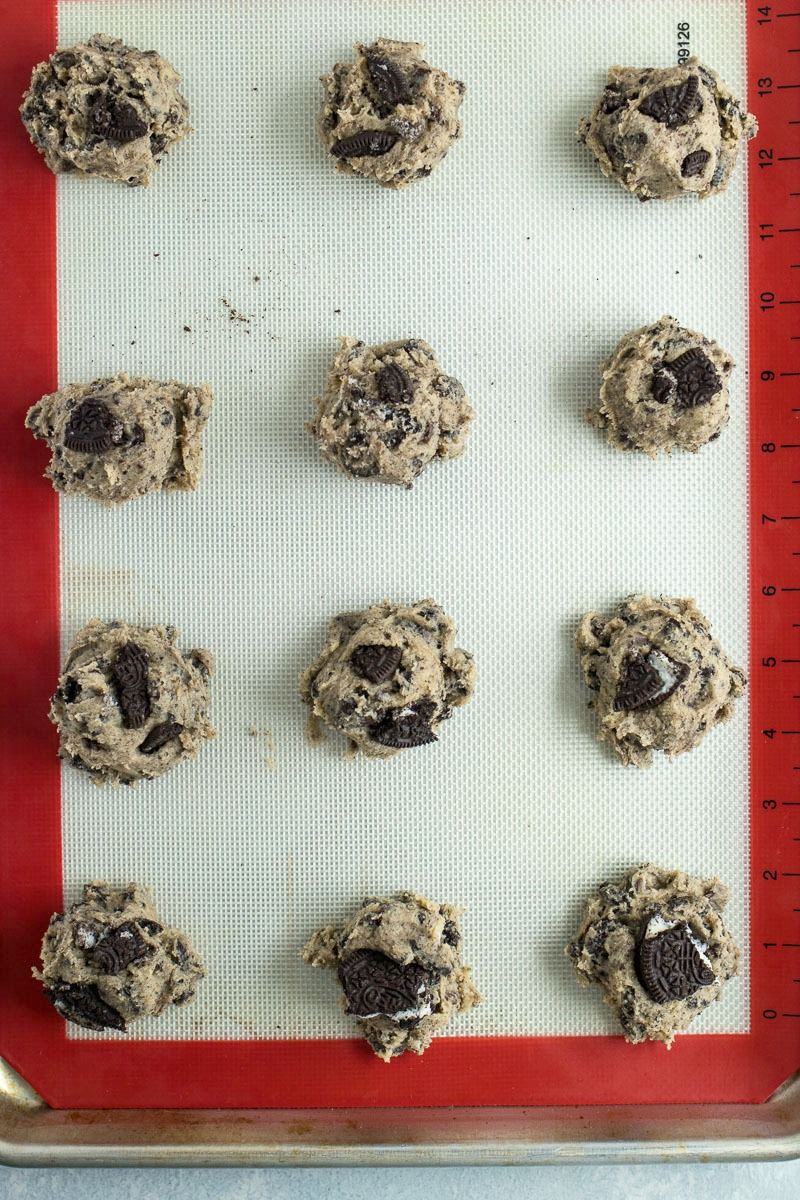 Oreo Chocolate Chip Cookies - Classic chocolate chip cookies are mixed with crushed Oreos to make for a mega cookie that is screaming to be dunked in a glass of milk.