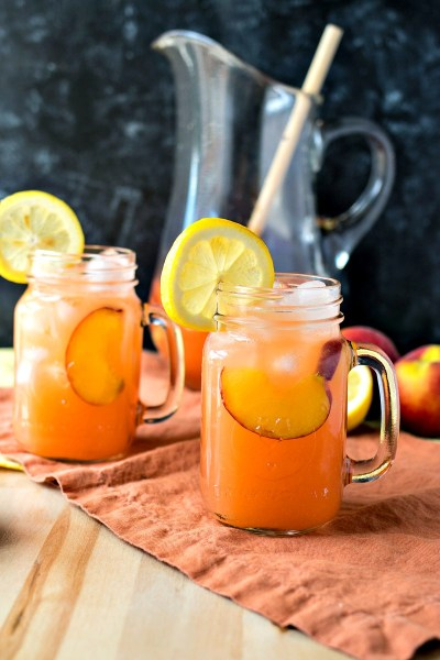 Peach Lemonade -Homemade lemonade is taken to a new level with the addition of fresh peaches. It will be your new favorite summer drink!