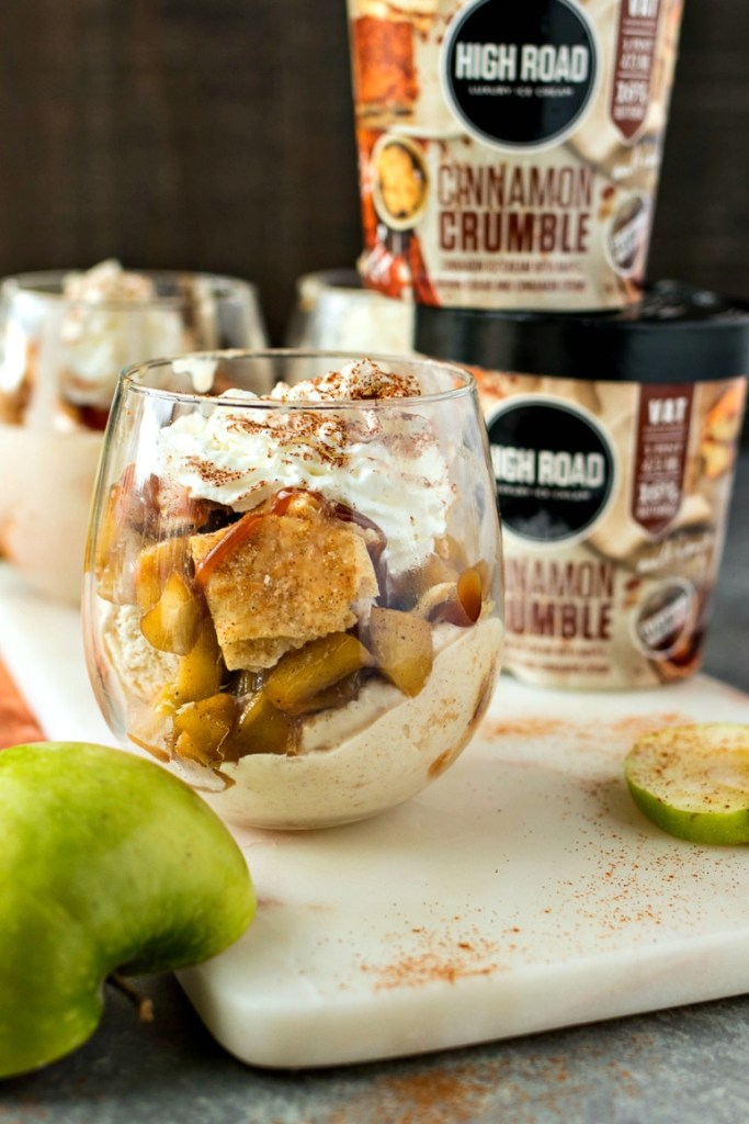 Apple Pie Sundae - High Road Cinnamon Crumble Ice Cream is topped with caramelized cinnamon apples, pie crust chips, and caramel sauce to make for a fun way to eat your favorite pie!