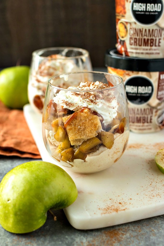 High Road Cinnamon Crumble Ice Cream is topped with caramelized cinnamon apples, pie crust chips, and caramel sauce