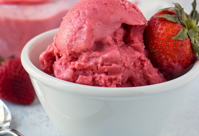 Strawberry Coconut Sorbet - Real strawberries are pureed with coconut milk, vanilla bean, honey, and sugar and then frozen to make an ultra creamy and refreshing sorbet