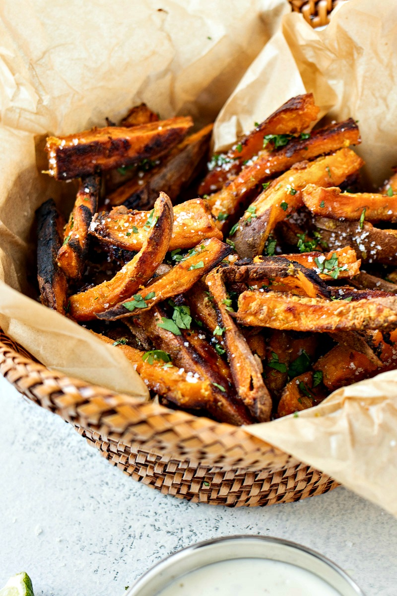Cilantro Lime Sweet Potato Fries - Sweet potatoes are tossed in garlic, lime zest, and olive oil, baked to perfection, and finished with a sprinkle of fresh chopped cilantro