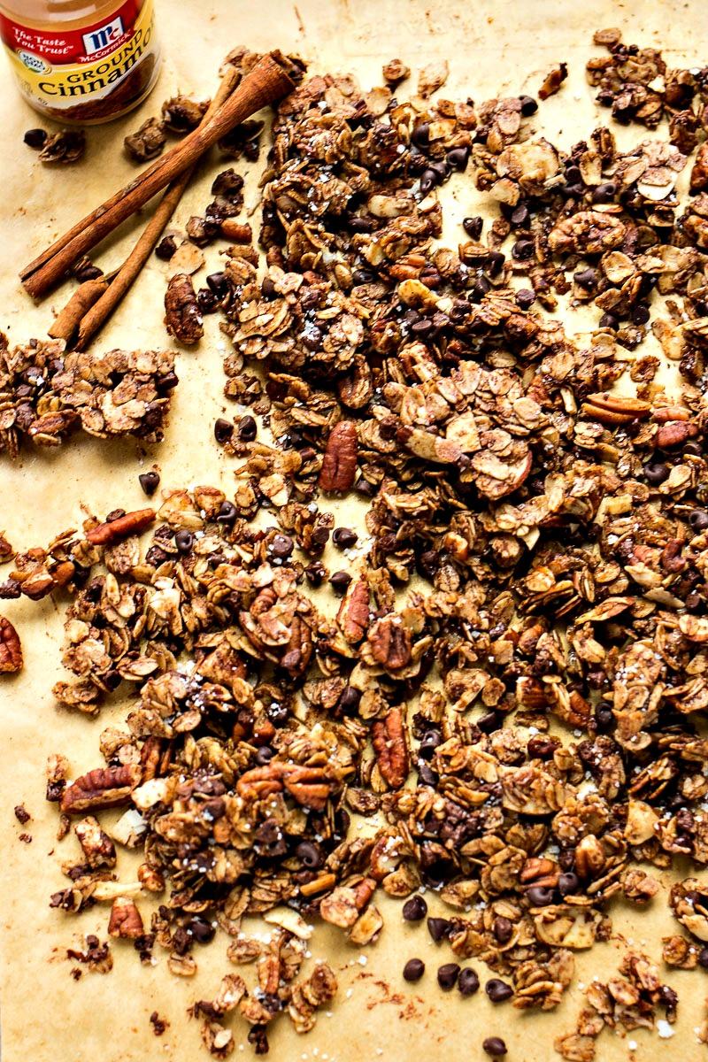Chocolate Cinnamon Granola spread across brown paper