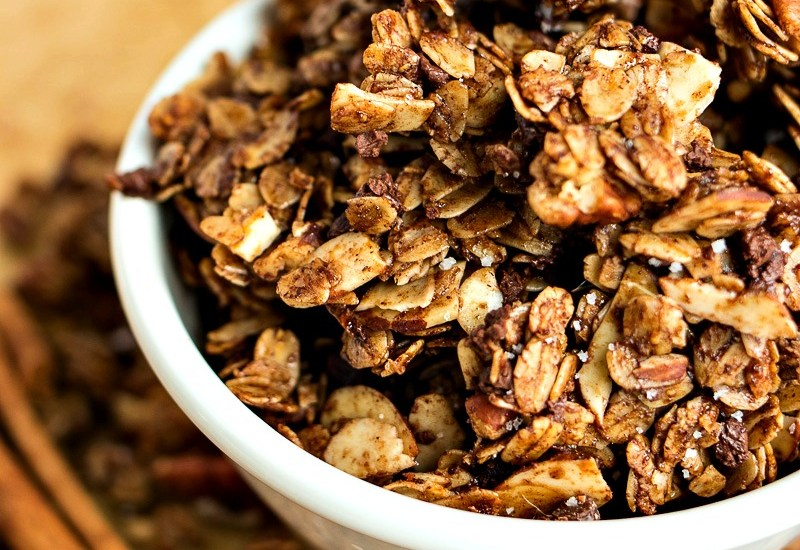 Chocolate Cinnamon Granola - Classic cinnamon granola is given a chocolatey makeover with the addition of cocoa powder and mini chocolate chips. You'll be shocked at how great the cinnamon and chocolate pairs together!