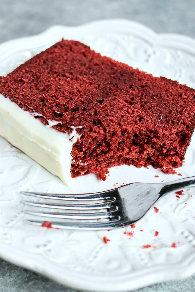 Red Velvet Loaf slice with a fork on a plate