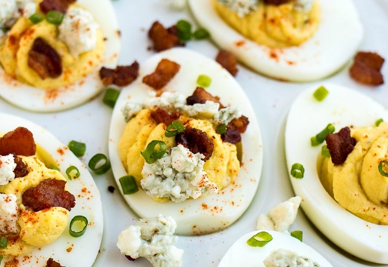 Bacon & Blue Cheese Deviled Eggs - Classic deviled eggs are taken to another level with the addition of blue cheese crumbles and bacon crumbles