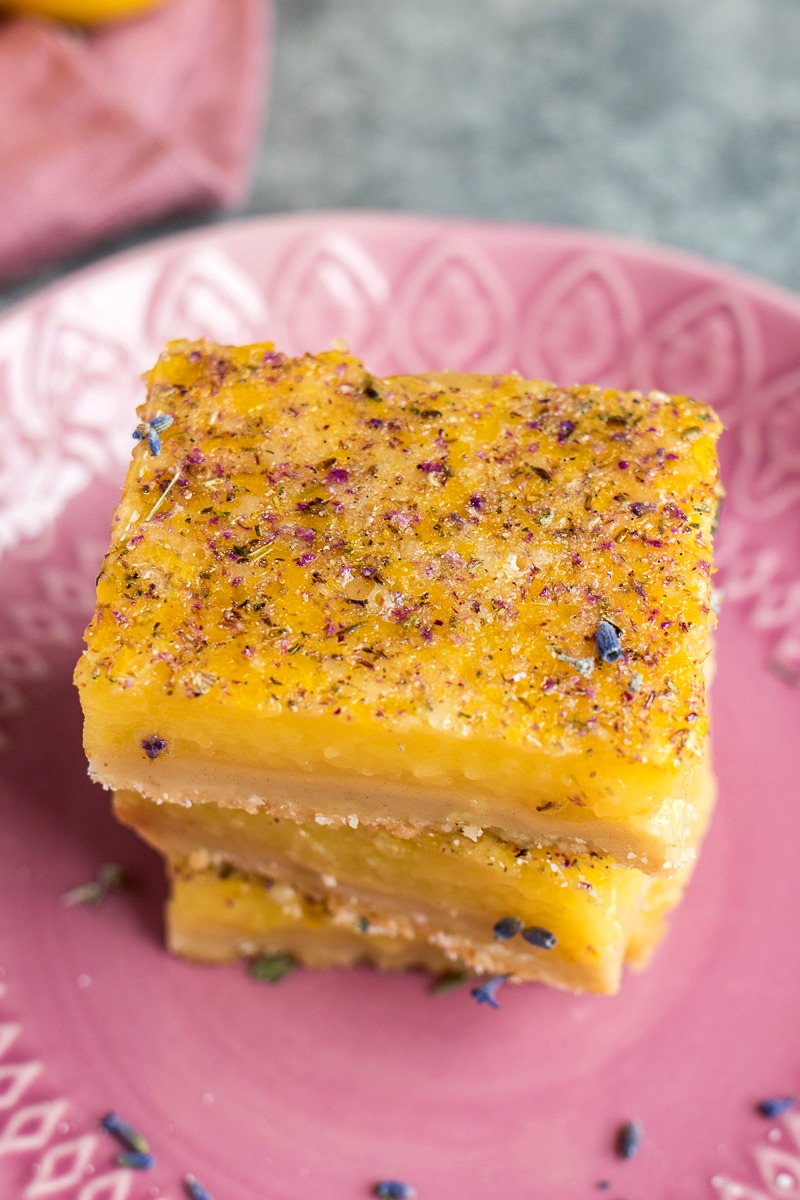 Top view of a stack of Lavender Vanilla Lemon Bars covered in lavender sugar