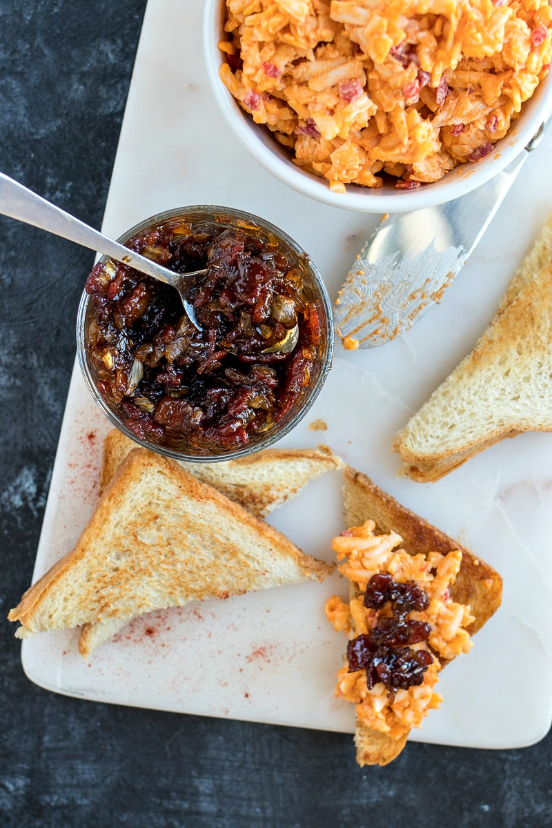 Bowl of Pimento Cheese  next to a jar of bacon jam