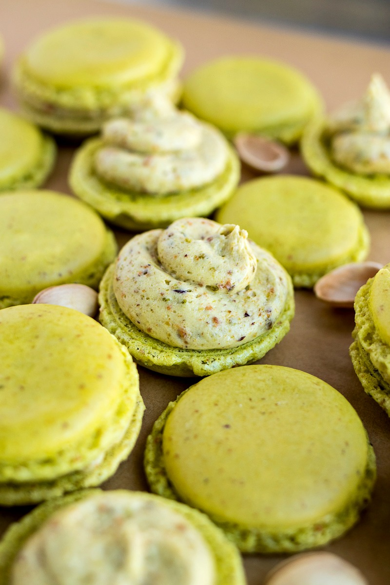 Pistachio Macarons before having the top cookie added