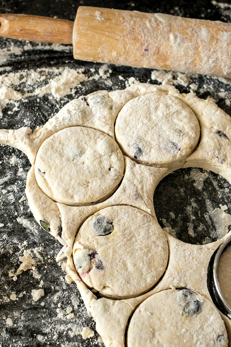 Blueberry Biscuit dough being cut into circles