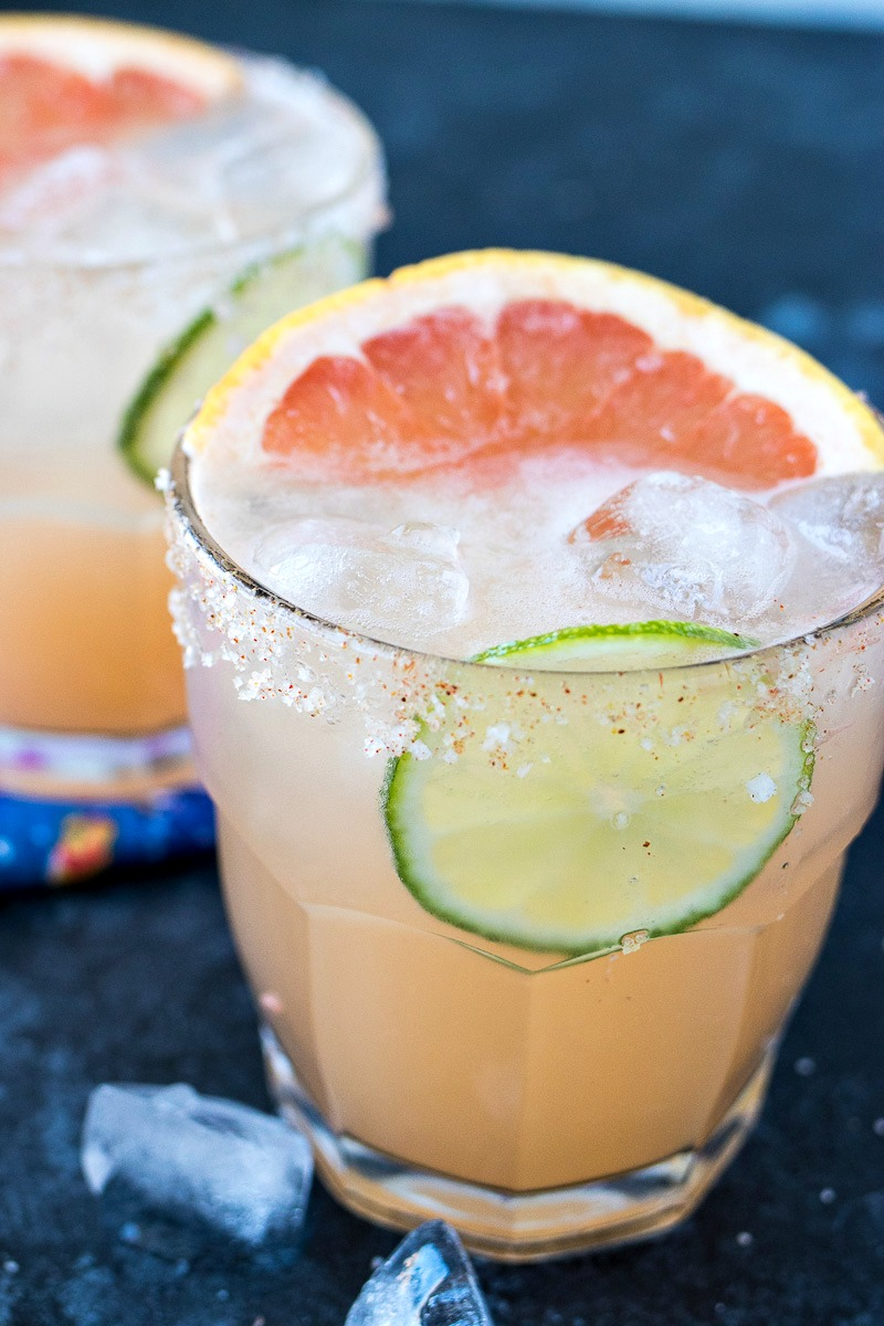 Palomas with a lime slice and grapefruit slice