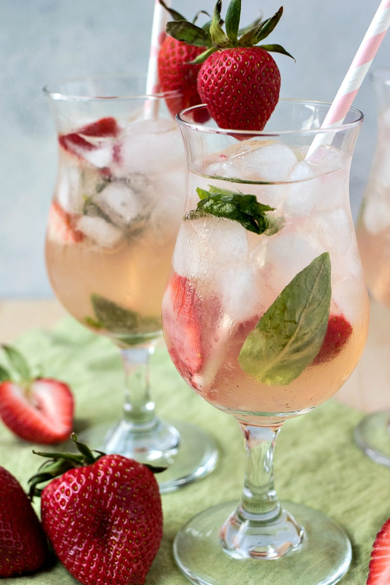Two glasses of Strawberry Basil Vodka Punch