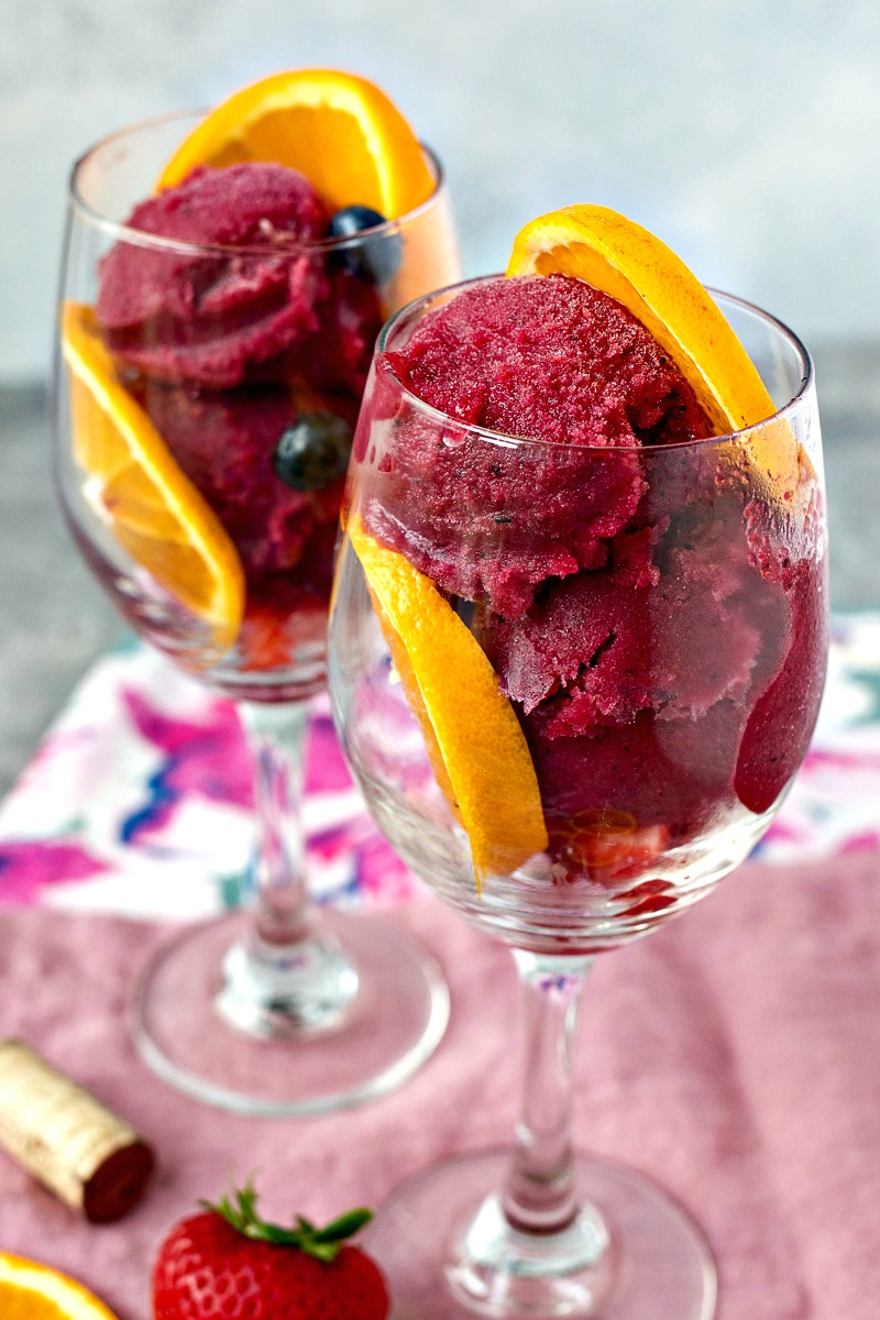 Glass of Sangria Sorbet with orange slices and blueberries
