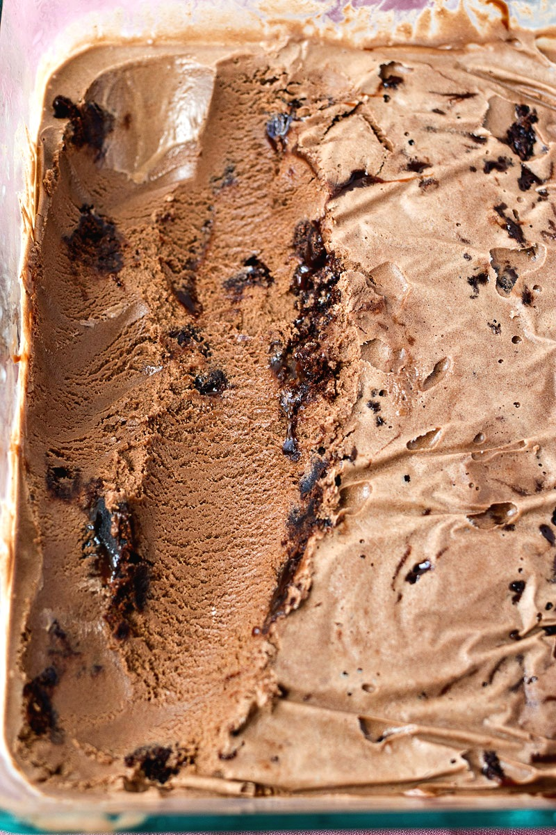 Pan of Fudge Brownie Ice Cream with parts missing from being scooped