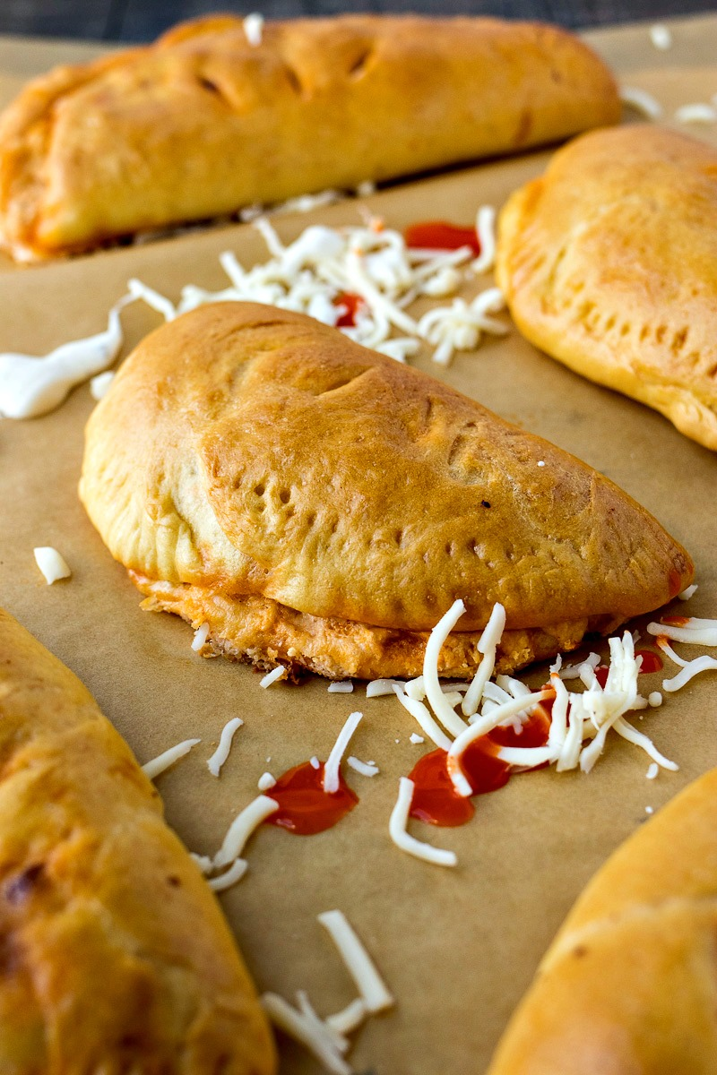 Buffalo Chicken Pockets on a sheet of brown paper