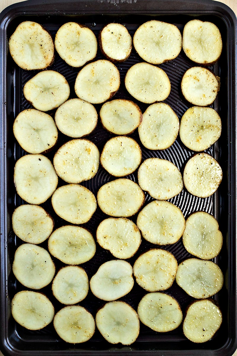 Slices of potato on a cookie sheet
