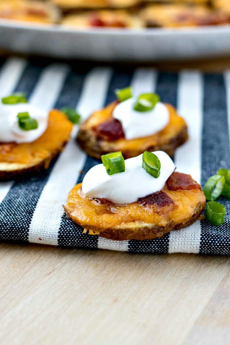 Potato Skin Bites topped with cheese, bacon and sour cream