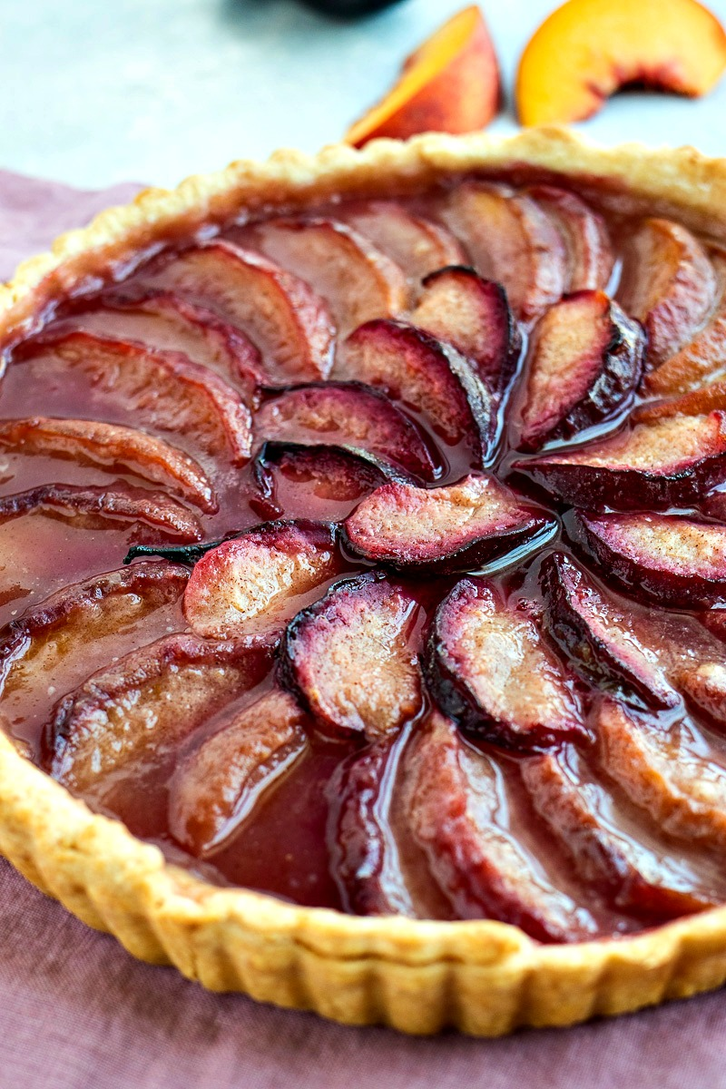 Stone Fruit Tart topped with slices of fruit