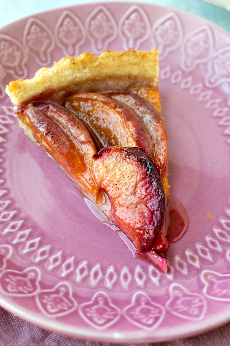 Piece of Stone Fruit Tart on a plate