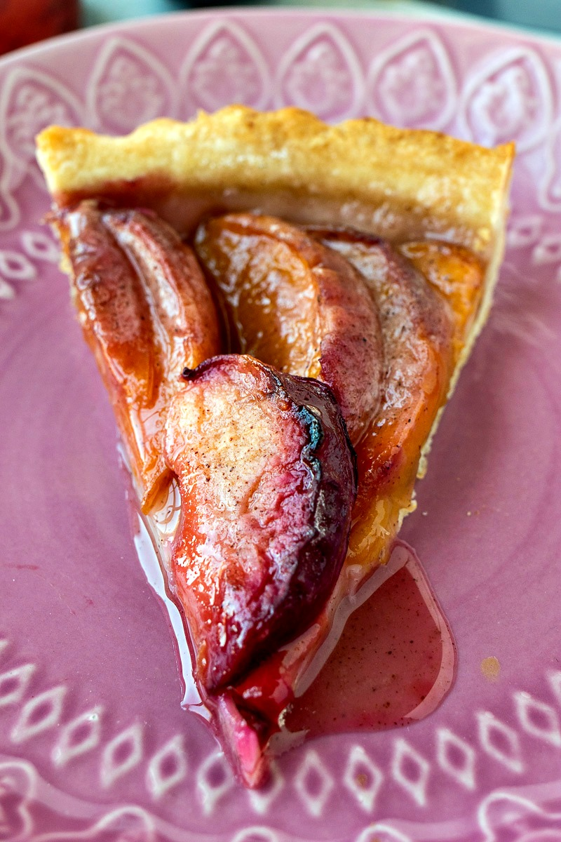 Plate of Stone Fruit Tart with peaches and plums