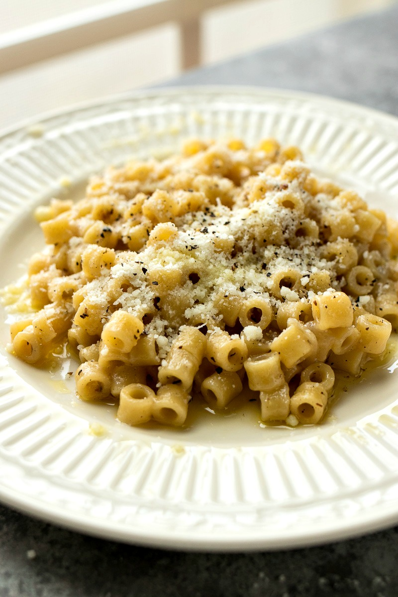 Plate of Cacio e Pepe Pasta Risotto topped with pepper and romano cheese
