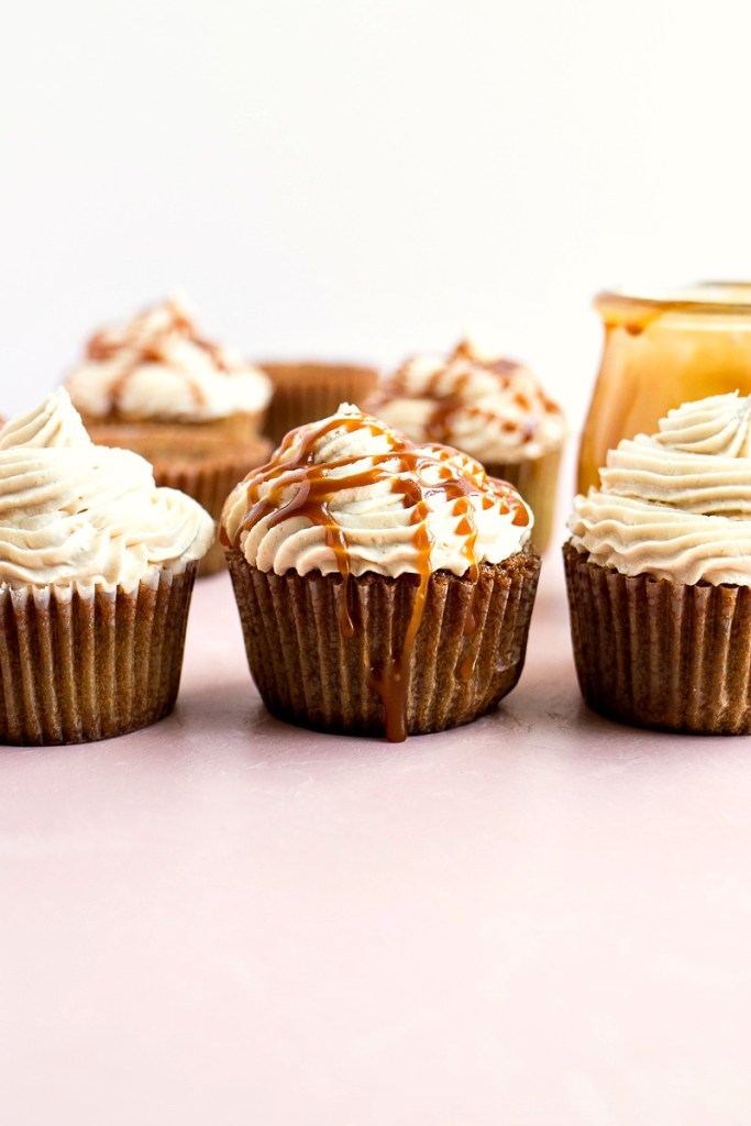 caramel macchiato cupcakes some drizzled with caramel sauce, shot from the front