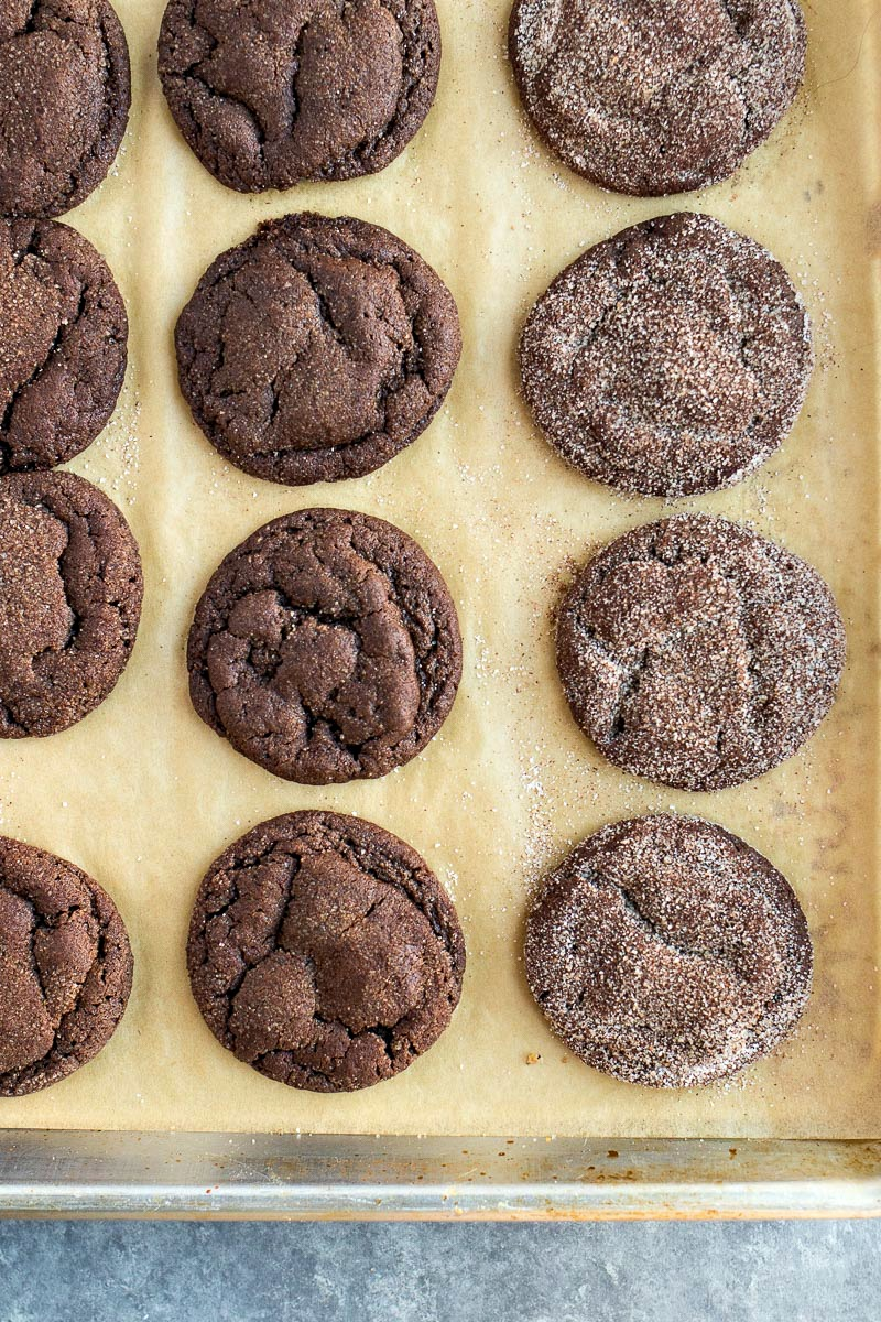tray of Chocolate Snickerdoodles being covered in cinnamon sugar
