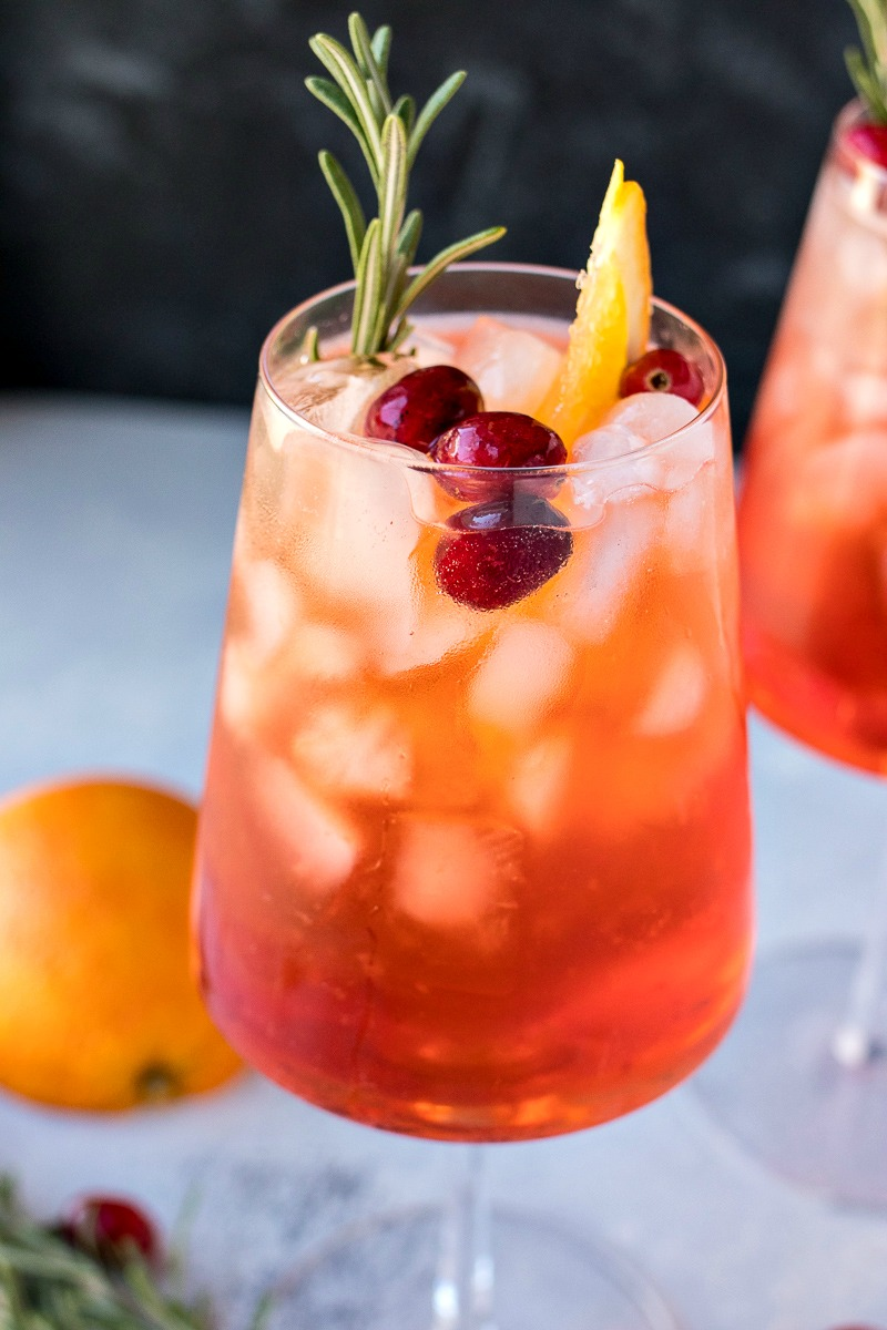 Cranberry Orange Aperol Spritz with cranberries and an orange slice in the glass