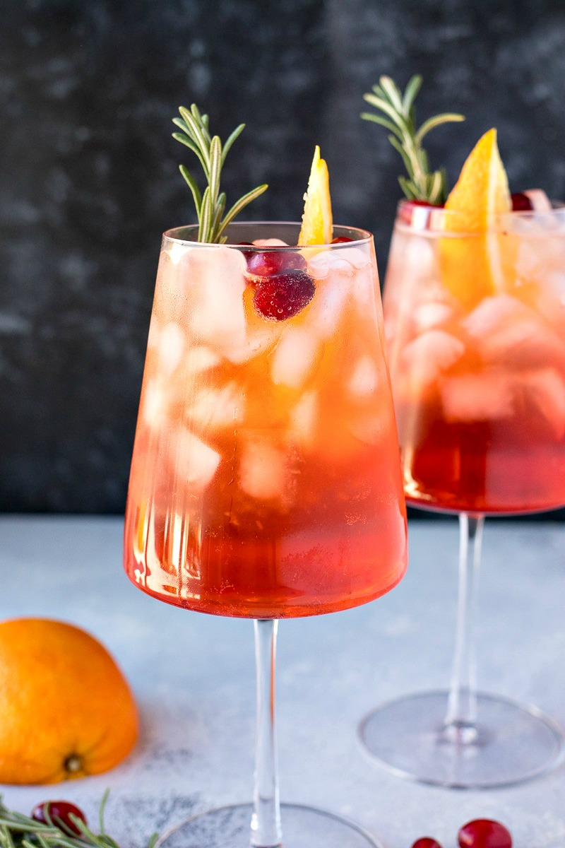 Two glasses of Cranberry Orange Aperol Spritz