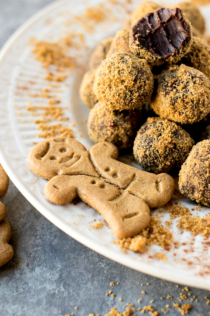 Gingerbread man on a plate of Chocolate Gingerbread Truffles