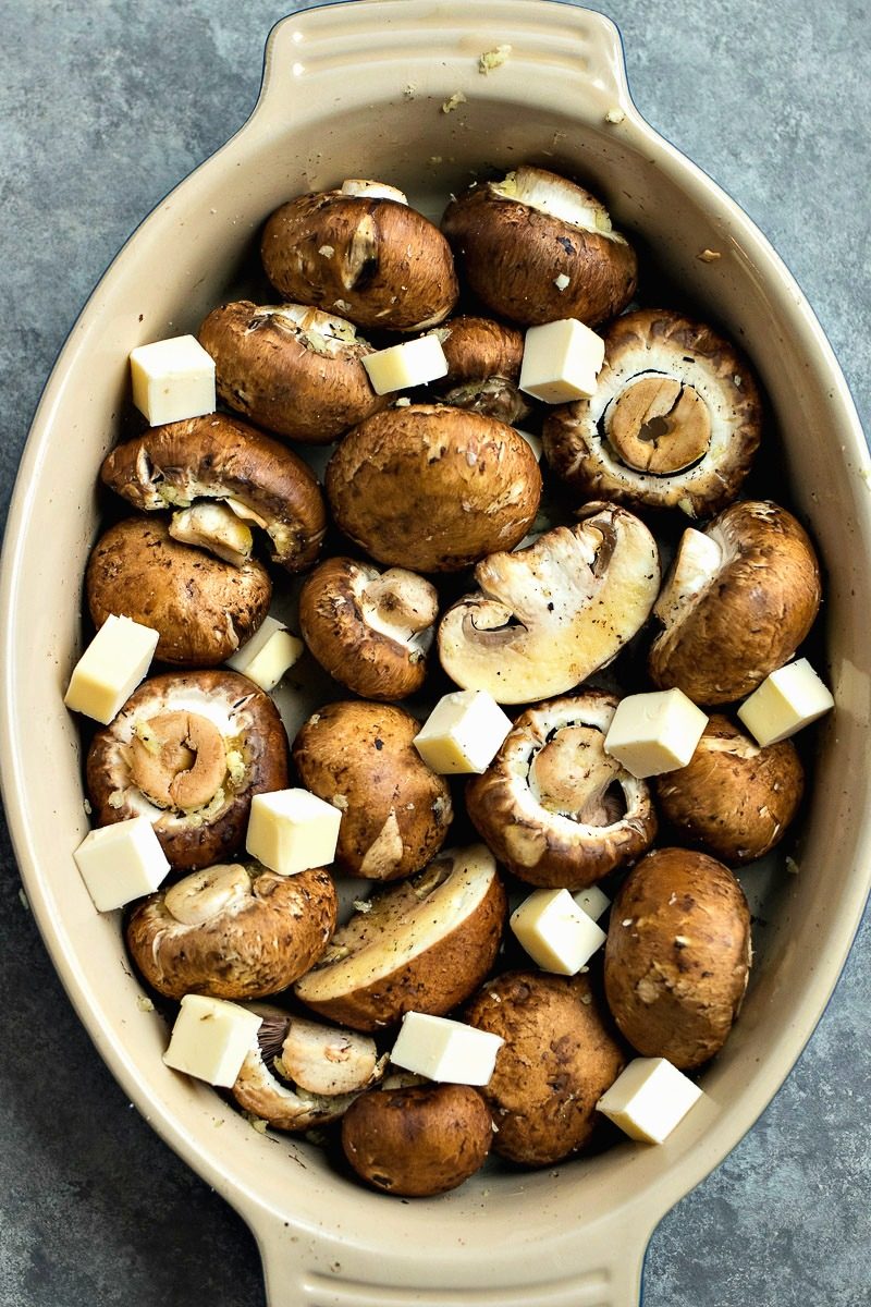 Casserole dish of mushrooms and slices of butter