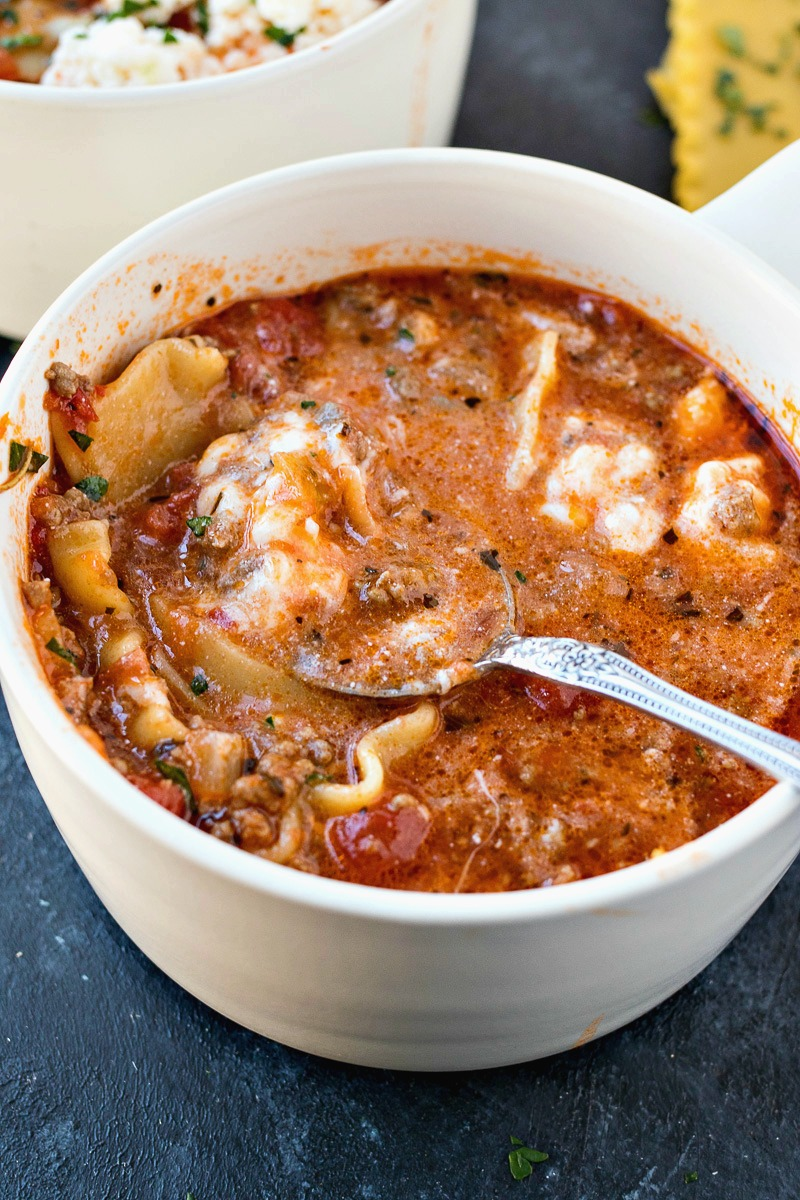 Spoonful of Lasagna Soup above a bowl of it
