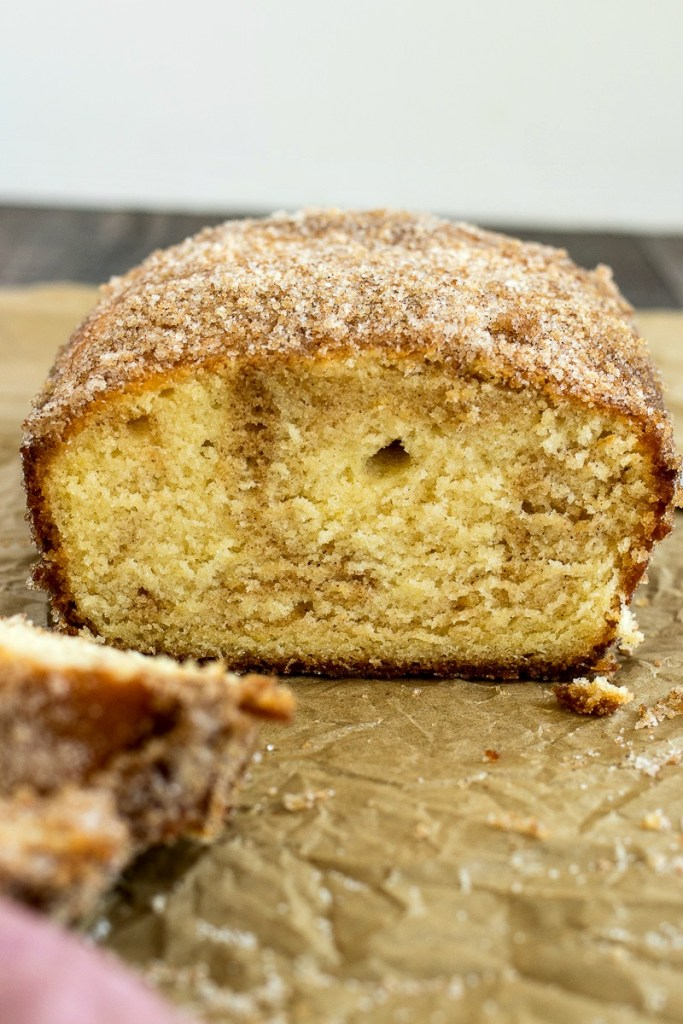 A loaf cake that has the texture of cake doughnuts and cinnamon flavor swirled throughout.