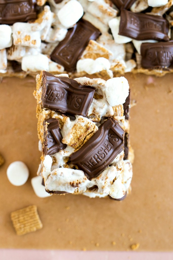 Golden Grahams cereals tossed with melted marshmallow and topped with more marshmallows and chocolate bar pieces