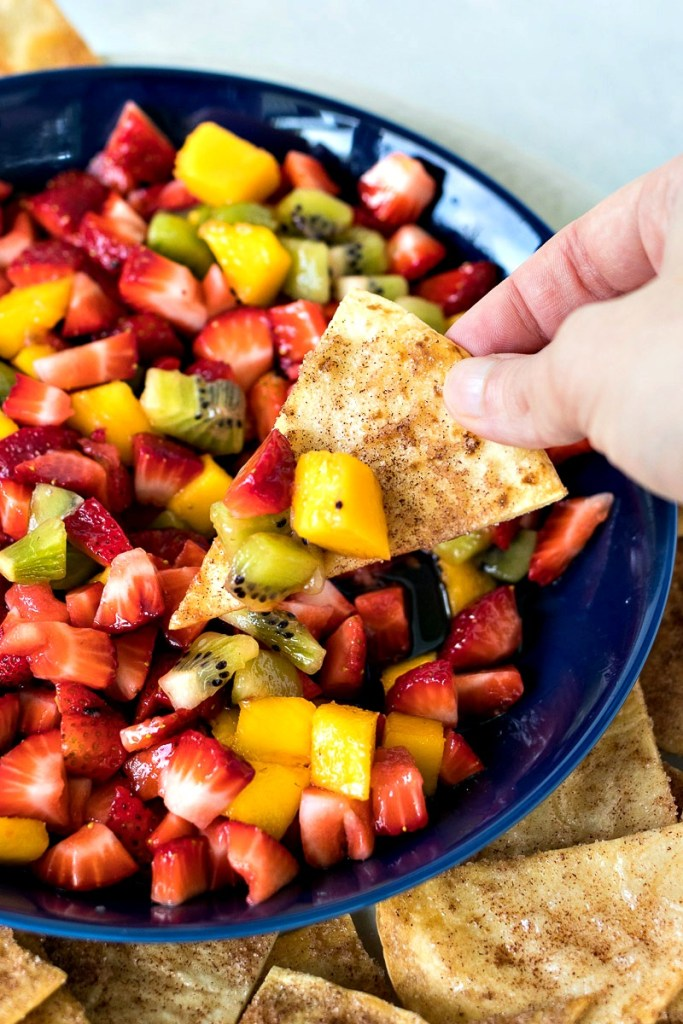 Cinnamon chip dipping into the Fruit Salsa