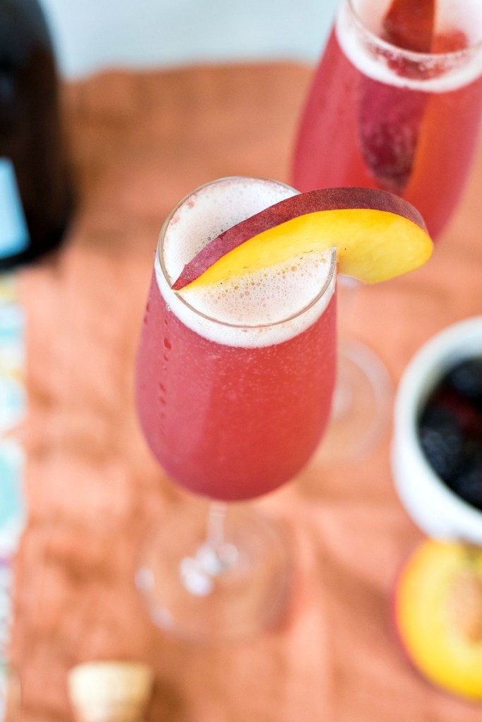Finished glass Summer Fruit Bellini topped with a peach slice