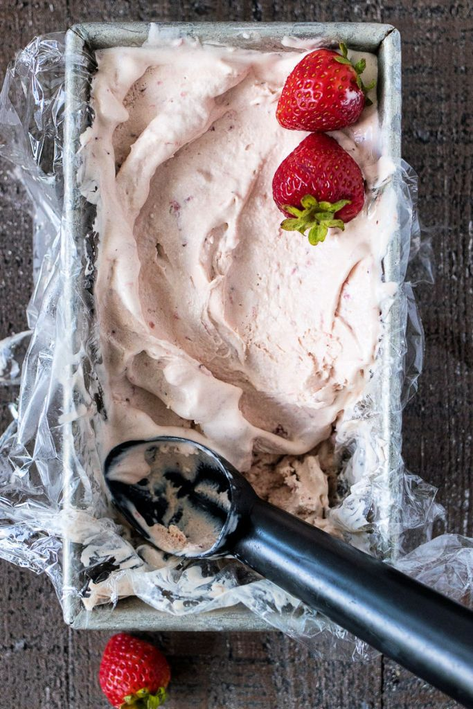 Pan of Strawberry Balsamic Ice Cream with whole strawberries on top