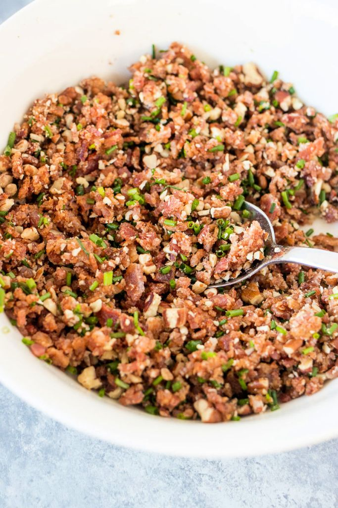 Bowl of crisp bacon crumbles, crunchy pecans and chopped chives