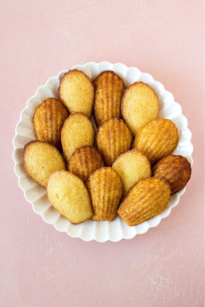 overhead shot of orange scented madelines on a white plate