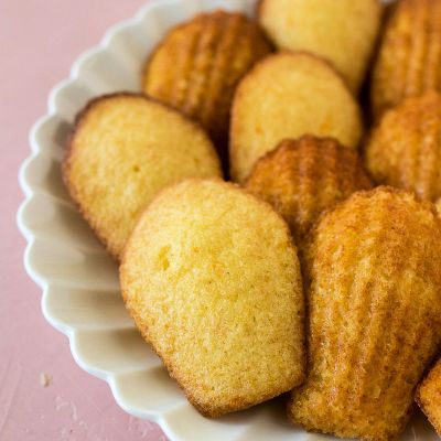 zoomed in shot of orange-scented madelines on a white plate