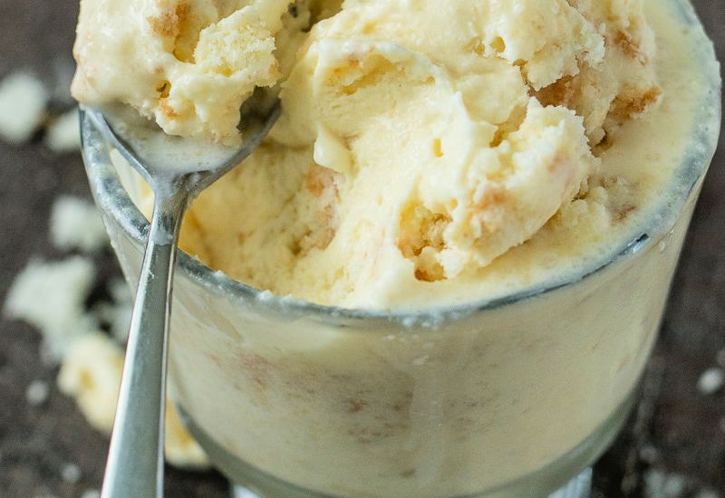 close up shot of wedding cake ice cream in a serving glass and a spoon