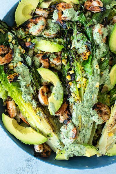 overhead shot of grilled shrimp summer salad in a large serving plate