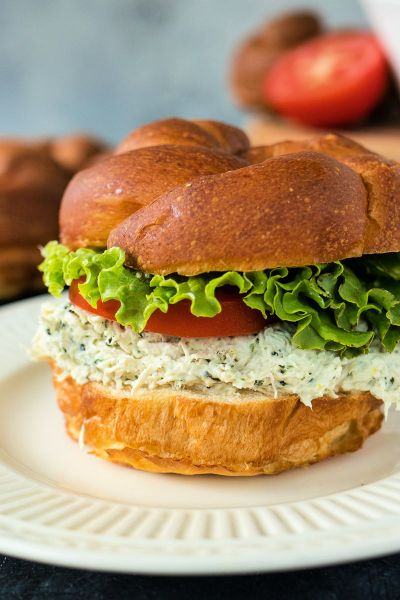 lemon basil chicken salad on a roll with lettuce and tomato
